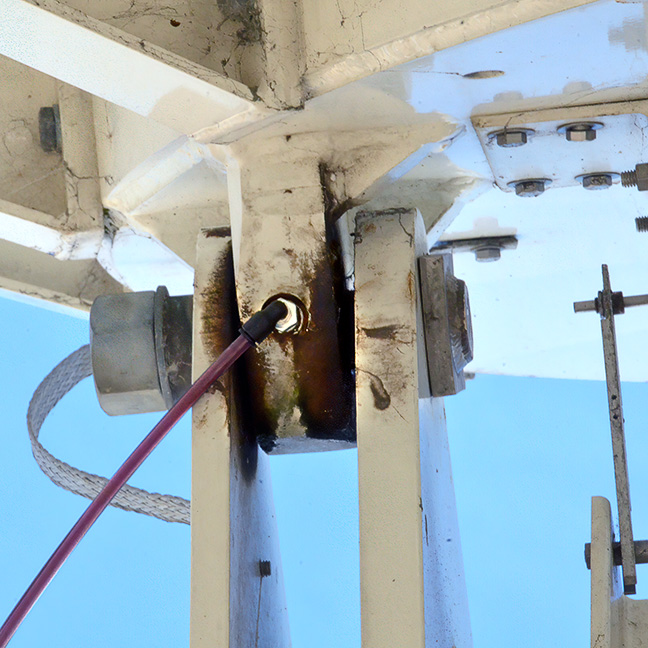 memolub lubricant line providing grease to a pivot pin of a general dynamics satellite earth station antenna